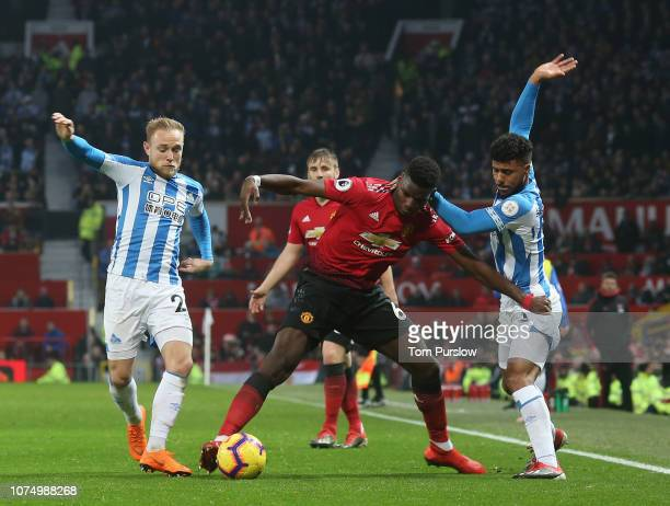 Paul Pogba of Manchester United in action with Alex Pritchard and Elias Kachunga of Huddersfield Town during the Premier League match between...