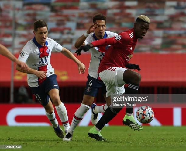 Paul Pogba of Manchester United in action with Ander Herrera of Paris Saint-Germain during the UEFA Champions League Group H stage match between...