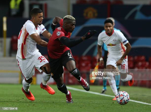 Paul Pogba of Manchester United in action with Benjamin Henrichs of RB Leipzig during the UEFA Champions League Group H stage match between...