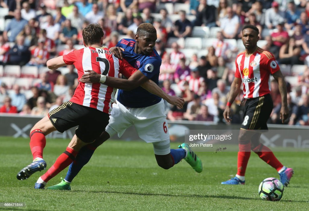Paul Pogba of Manchester United in action with Billy Jones of Sunderland during the Premier League match between Sunderland and Manchester United at Stadium of Light on April 9, 2017 in Sunderland, England.