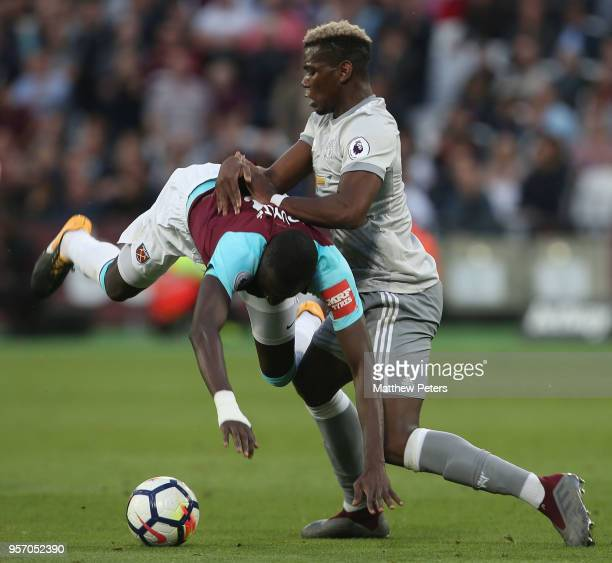 Paul Pogba of Manchester United in action with Cheikhou Kouyate of West Ham United during the Premier League match between West Ham United and...