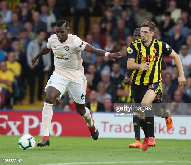 Paul Pogba of Manchester United in action with Craig Cathcart of Watford during the Premier League match between Watford FC and Manchester United at...