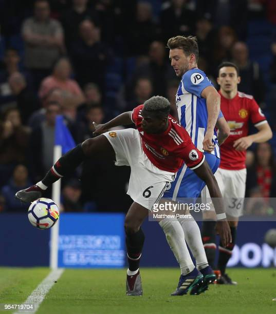 Paul Pogba of Manchester United in action with Dale Stephens of Brighton and Hove Albion during the Premier League match between Brighton and Hove...