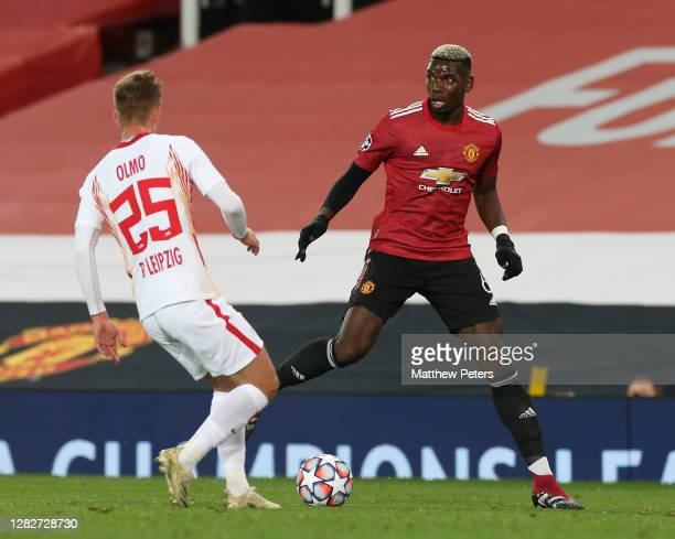Paul Pogba of Manchester United in action with Dani Olmo of RB Leipzig during the UEFA Champions League Group H stage match between Manchester United...