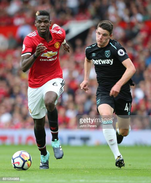 Paul Pogba of Manchester United in action with Declan Rice of West Ham United during the Premier League match between Manchester United and West Ham...