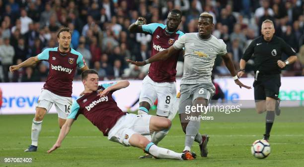 Paul Pogba of Manchester United in action with Declan Rice of West Ham United during the Premier League match between West Ham United and Manchester...