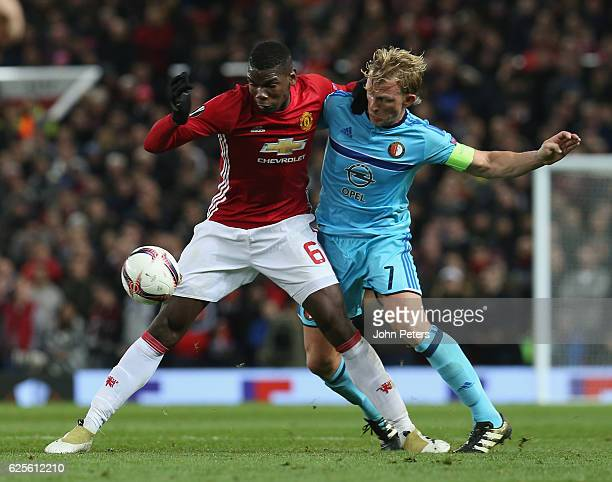 Paul Pogba of Manchester United in action with Dirk Kuyt of Feyenoord during the UEFA Europa League match between Manchester United FC and Feyenoord...
