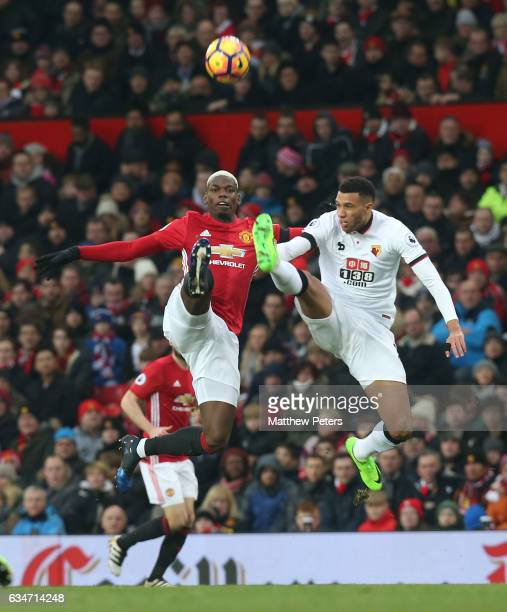 Paul Pogba of Manchester United in action with Etienne Capoue of Watford during the Premier League match between Manchester United and Watford at Old...
