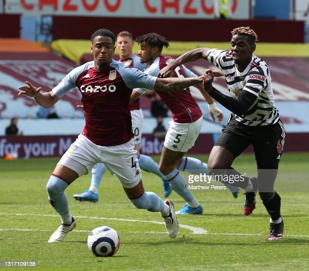 Paul Pogba of Manchester United in action with Ezri Konsa of Aston Villa during the Premier League match between Aston Villa and Manchester United at...