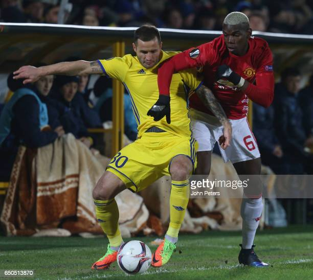Paul Pogba of Manchester United in action with Fedor Kudryashov of FK Rostov during the UEFA Europa League Round of 16 first leg match between FK...