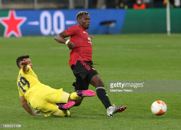 Paul Pogba of Manchester United in action with Francis Coquelin of Villareal CF during the UEFA Europa League Final between Villarreal CF and...