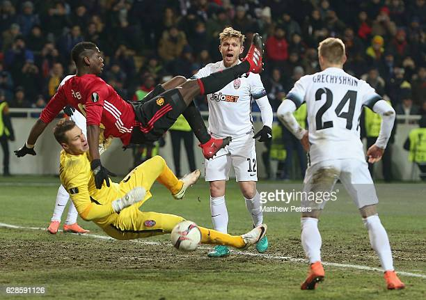Paul Pogba of Manchester United in action with Ihor Levchenko of FC Zorya Luhansk during the UEFA Europa League match between FC Zorya Luhansk and...