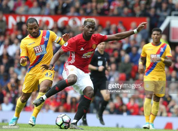 Paul Pogba of Manchester United in action with Jason Puncheon of Crystal Palace during the Premier League match between Manchester United and Crystal...