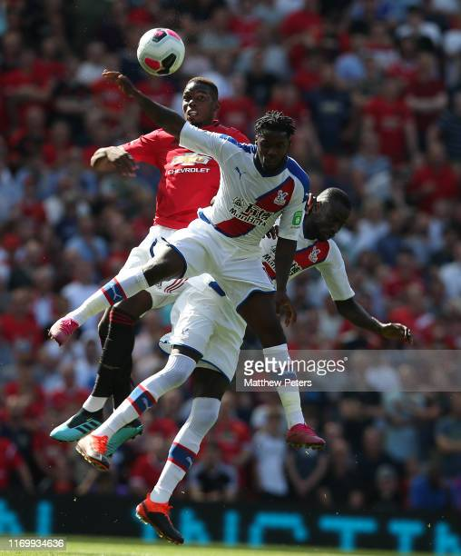 Paul Pogba of Manchester United in action with Jeffrey Schlupp and Cheikhou Kouyate of Crystal Palace during the Premier League match between...