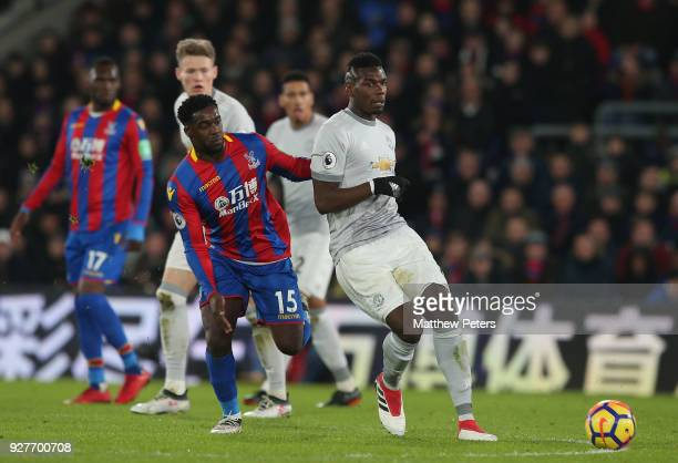 Paul Pogba of Manchester United in action with Jeffrey Schlupp of Crystal Palace during the Premier League match between Crystal Palace and...