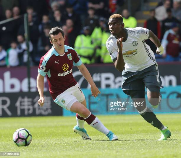 Paul Pogba of Manchester United in action with Joey Barton of Burnley during the Premier League match between Burnley and Manchester United at Turf...