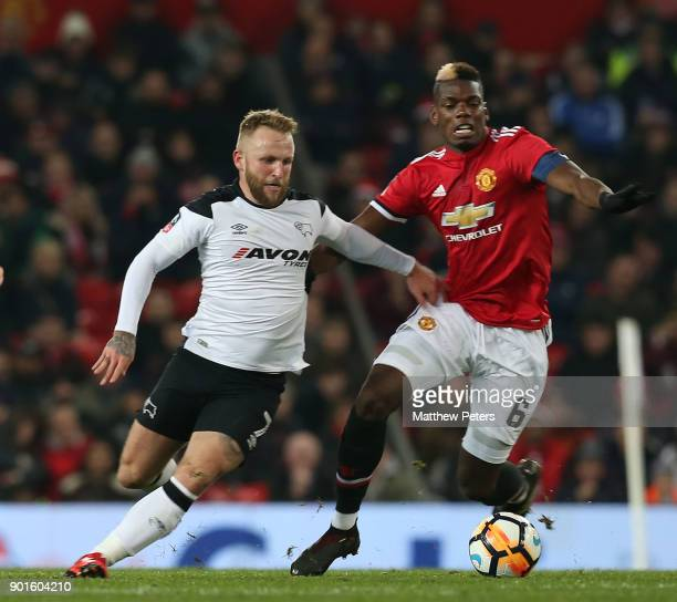 Paul Pogba of Manchester United in action with Johnny Russell of Derby County during the Emirates FA Cup Third Round match between Manchester United...