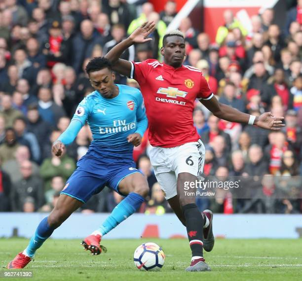 Paul Pogba of Manchester United in action with Joseph Willock of Arsenal during the Premier League match between Manchester United and Arsenal at Old...