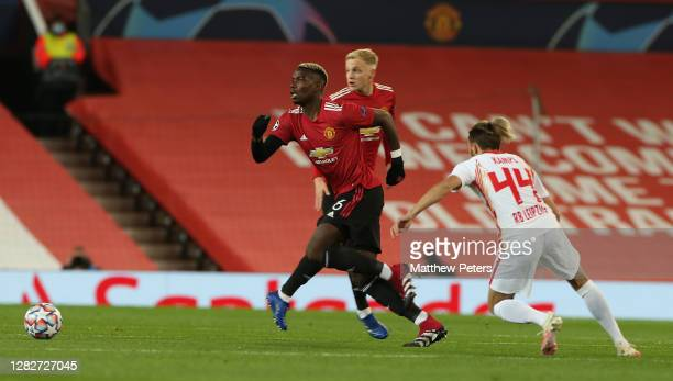 Paul Pogba of Manchester United in action with Kevin Kampl of RB Leipzig during the UEFA Champions League Group H stage match between Manchester...