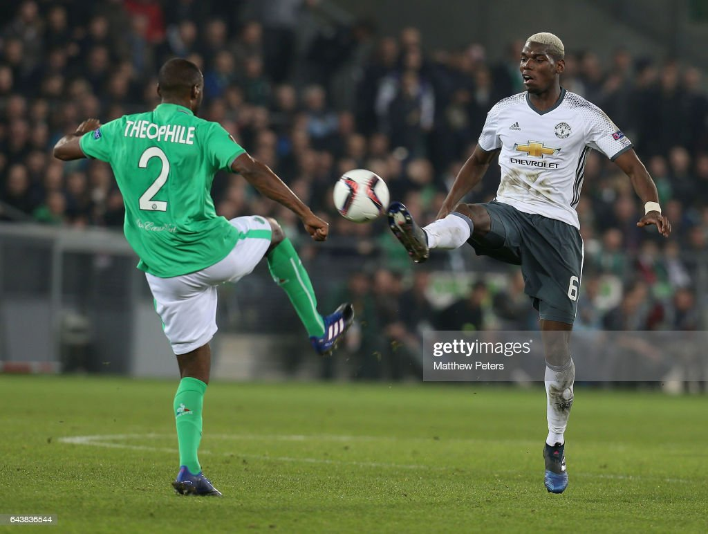 Paul Pogba of Manchester United in action with Kevin Theophile-Catherine of AS Saint-Etienne during the UEFA Europa League Round of 32 second leg match between AS Saint-Etienne and Manchester United at Stade Geoffroy-Guichard on February 22, 2017 in Saint-Etienne, France.