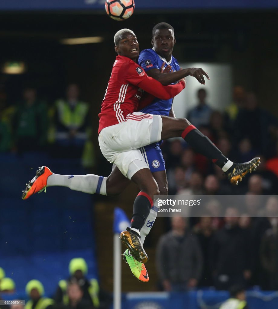 Paul Pogba of Manchester United in action with Kurt Zouma of Chelsea during the Emirates FA Cup Quarter-Final match between Chelsea and Manchester United at Stamford Bridge on March 13, 2017 in London, England.