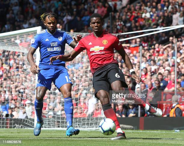 Paul Pogba of Manchester United in action with Leandro Bacuna of Cardiff City during the Premier League match between Manchester United and Cardiff...