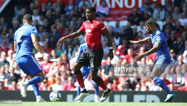 Paul Pogba of Manchester United in action with Lee Peltier and Leandro Bacuna of Cardiff City during the Premier League match between Manchester...