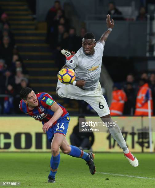 Paul Pogba of Manchester United in action with Martin Kelly of Crystal Palace during the Premier League match between Crystal Palace and Manchester...