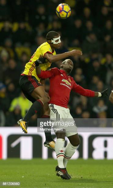 Paul Pogba of Manchester United in action with Marvin Zeegelaar of Watford during the Premier League match between Watford and Manchester United at...