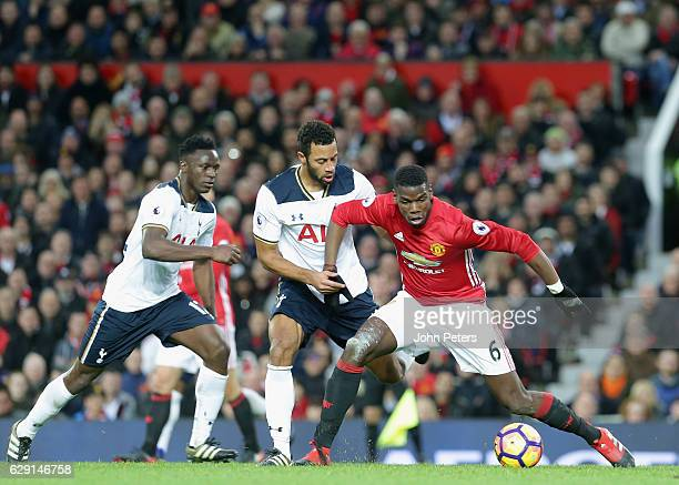 Paul Pogba of Manchester United in action with Moussa Sissoko and Mousa Dembele of Tottenham Hotspur during the Premier League match between...