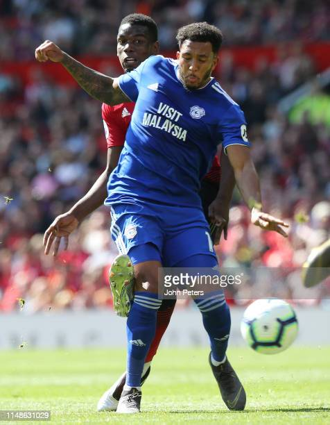 Paul Pogba of Manchester United in action with Nathaniel MendezLaing of Cardiff City during the Premier League match between Manchester United and...