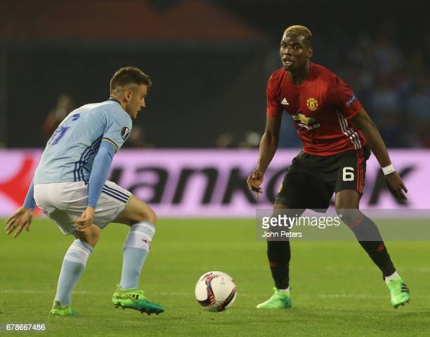 Paul Pogba of Manchester United in action with Nemanja Radoja of Celta Vigo during the UEFA Europa League semifinal first leg match between Celta...