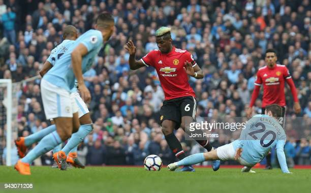 Paul Pogba of Manchester United in action with Nicolas Otamendi of Manchester City during the Premier League match between Manchester City and...
