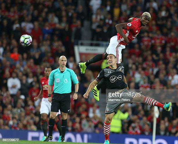 Paul Pogba of Manchester United in action with Oriol Romeu of Southampton during the Premier League match between Manchester United and Southampton...