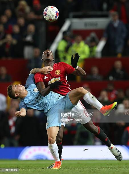 Paul Pogba of Manchester United in action with Pablo Maffeo of Manchester City during the EFL Cup Fourth Round match between Manchester United and...