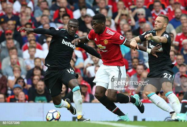 Paul Pogba of Manchester United in action with Pedro Obiang and Marko Arnautovic of West ham United during the Premier League match between...