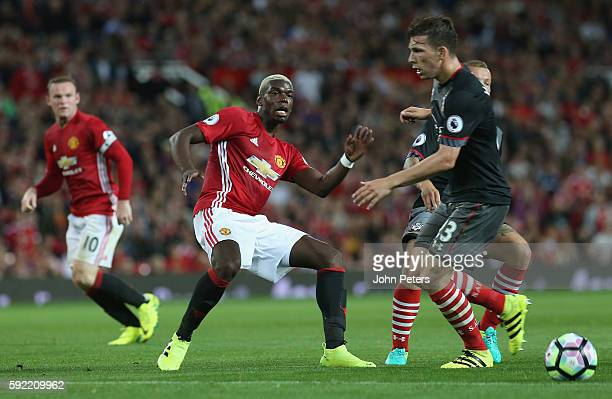 Paul Pogba of Manchester United in action with PierreEmile Hojbjerg of Southampton during the Premier League match between Manchester United and...