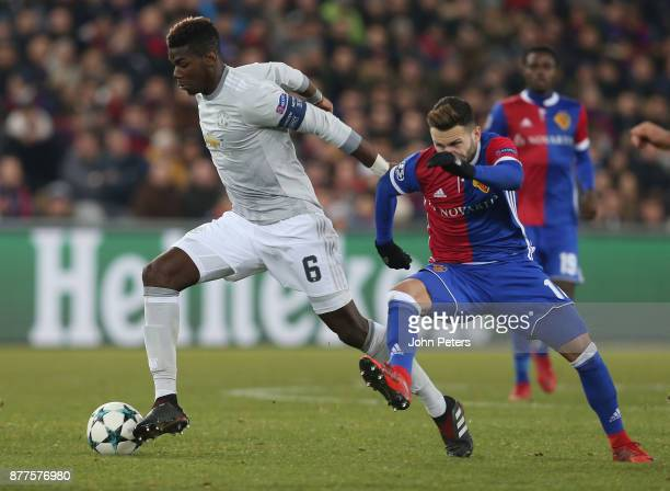 Paul Pogba of Manchester United in action with Renato Steffen of FC Basel during the UEFA Champions League group A match between FC Basel and...