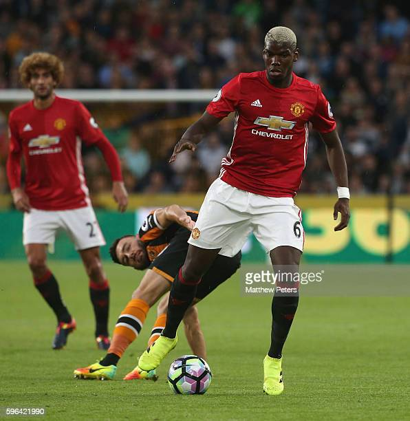 Paul Pogba of Manchester United in action with Robert Snodgrass of Hull City during the Premier League match between Manchester United and Hull City...