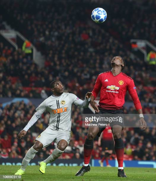 Paul Pogba of Manchester United in action with Roger Assale of BSC Young Boys during the Group H match of the UEFA Champions League between...