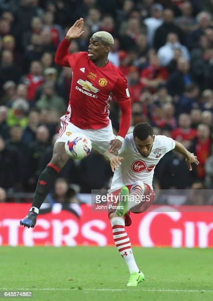 Paul Pogba of Manchester United in action with Ryan Bertrand of Southampton during the EFL Cup Final match between Manchester United and Southampton...
