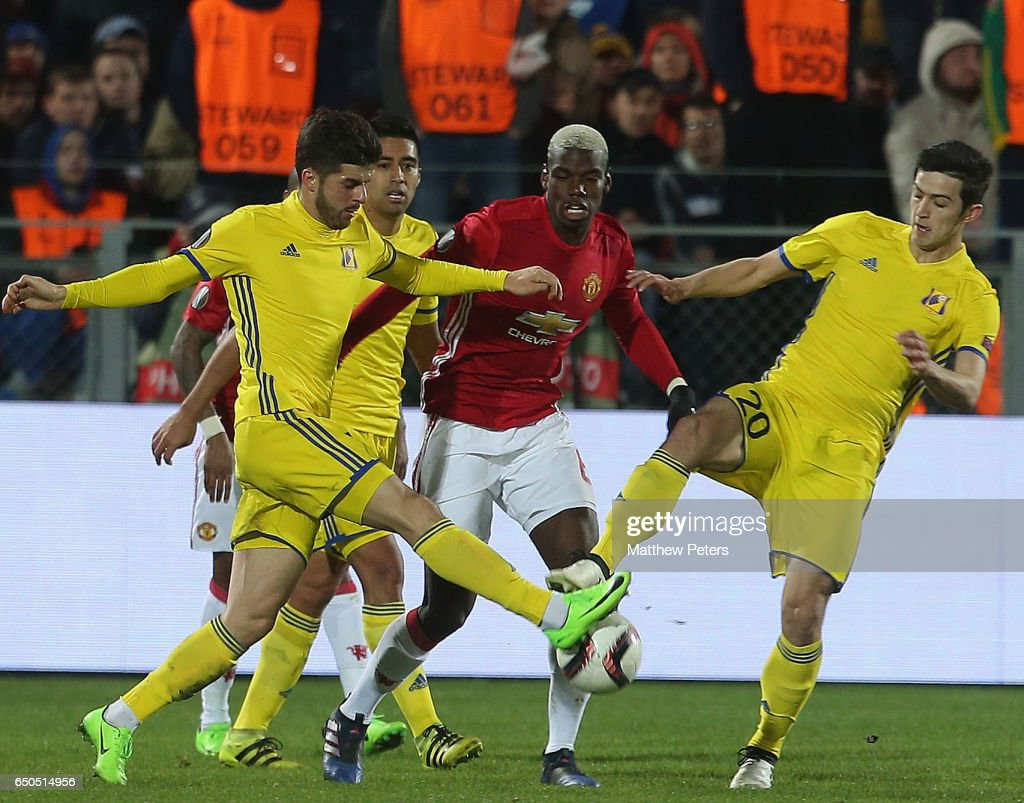 Paul Pogba of Manchester United in action with Sardar Azmoun of FK Rostov during the UEFA Europa League Round of 16 first leg match between FK Rostov and Manchester United at Olimp-2 on March 9, 2017 in Rostov-on-Don, Russia.