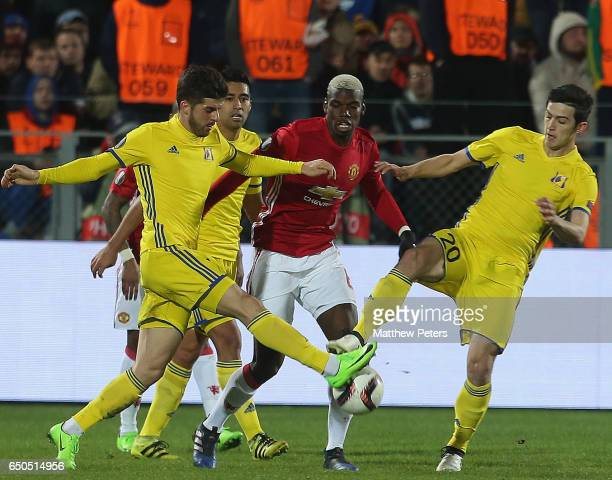 Paul Pogba of Manchester United in action with Sardar Azmoun of FK Rostov during the UEFA Europa League Round of 16 first leg match between FK Rostov...