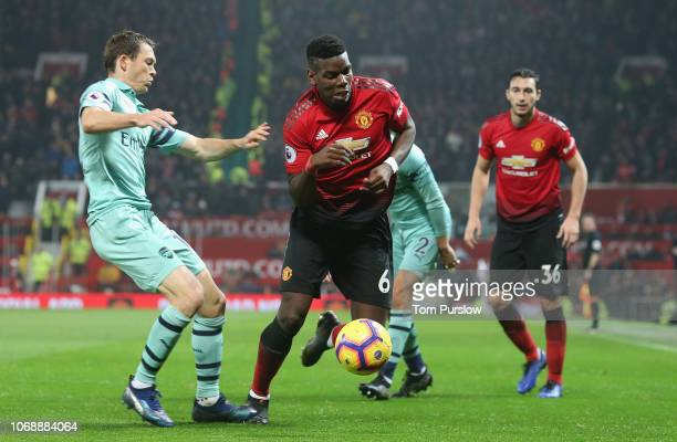 Paul Pogba of Manchester United in action with Stephan Lichtsteiner of Arsenal during the Premier League match between Manchester United and Arsenal...