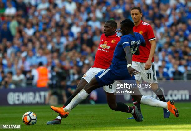 Paul Pogba of Manchester United in action with Tiemoue Bakayoko of Chelsea during the Emirates FA Cup Final match between Manchester United and...