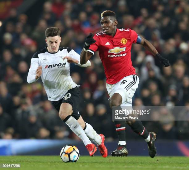 Paul Pogba of Manchester United in action with Tom Lawrence of Derby County during the Emirates FA Cup Third Round match between Manchester United...