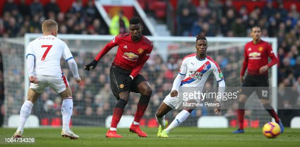 Paul Pogba of Manchester United in action with Wilfried Zaha of Crystal Palace during the Premier League match between Manchester United and Crystal...