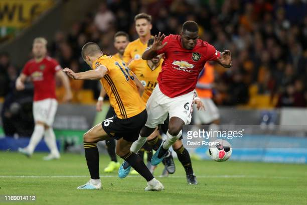 Paul Pogba of Manchester United is brought down by Conor Coady of Wolverhampton Wanderers in the box which leads to a penalty for Manchester United...