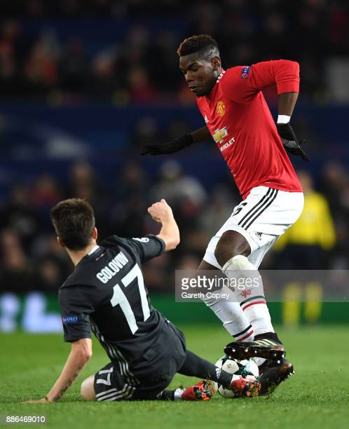 Paul Pogba of Manchester United is challenged by Aleksandr Golovin of CSKA Moscow during the UEFA Champions League group A match between Manchester...