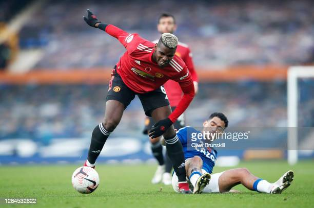 Paul Pogba of Manchester United is challenged by Allan of Everton during the Premier League match between Everton and Manchester United at Goodison...